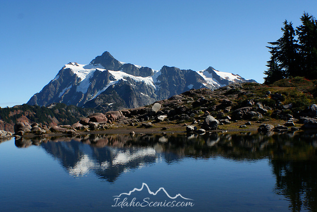 Mt Shuksan reflected in a high mountain pond. North Cascade range of Washington State.