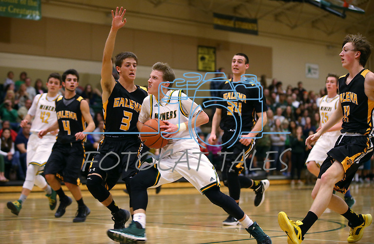 Manogue's Collin Bernard drives past Galena defender Scott Geerling at Manogue High School in Reno, Nev., on Tuesday, Feb. 11, 2014. Manogue won 66-59.<br /> Photo by Cathleen Allison