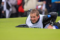Robert Rocks caddy lines up his bosses putt in the playoff of the 2009 Irish Open