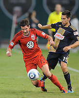 DC United midfielder Chris Pontius (13) gets fouled by Philadelphia Union midfielder Gabriel Farfan (15)  Philadelphia Union tied DC United 2-2, at RFK Stadium, Saturday July 2, 2011.