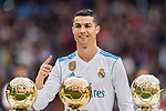 Cristiano Ronaldo of Real Madrid poses for photos with his FIFA Ballon Dor Trophies during the La Liga 2017-18 match between Real Madrid and Sevilla FC at Santiago Bernabeu Stadium on 09 December 2017 in Madrid, Spain. Photo by Diego Souto / Power Sport Images