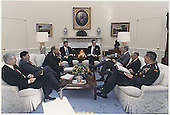Washington, DC - January 15, 1991 -- United States President George H.W. Bush meets in the Oval Office with Chairman of the Joint Chiefs of Staff General Colin Powell, National Security Advisor General Brent Scowcroft, United States Secretary of State James A. Baker III, Vice President Dan Quayle,  United States Secretary of Defense Dick Cheney, White House Chief of Staff John Sununu and Robert Gates about the situation in the Persian Gulf and Operation Desert Shield on January 15, 1991..Credit: The White House via CNP