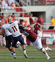NWA Democrat-Gazette/ANDY SHUPE<br /> Arkansas' Mitchell Loewen (right) hurries University of Texas at El Paso's Mack Leftwich Saturday, Sept. 5, 2015, during the third quarter of play in Razorback Stadium in Fayetteville. Visit nwadg.com/photos to see more from the game.