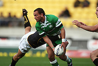 Manawatu's Aaron Cruden passes in the tackle. Air NZ Cup - Wellington Lions v Manawatu Turbos at Westpac Stadium, Wellington, New Zealand. Saturday 3 October 2009. Photo: Dave Lintott / lintottphoto.co.nz