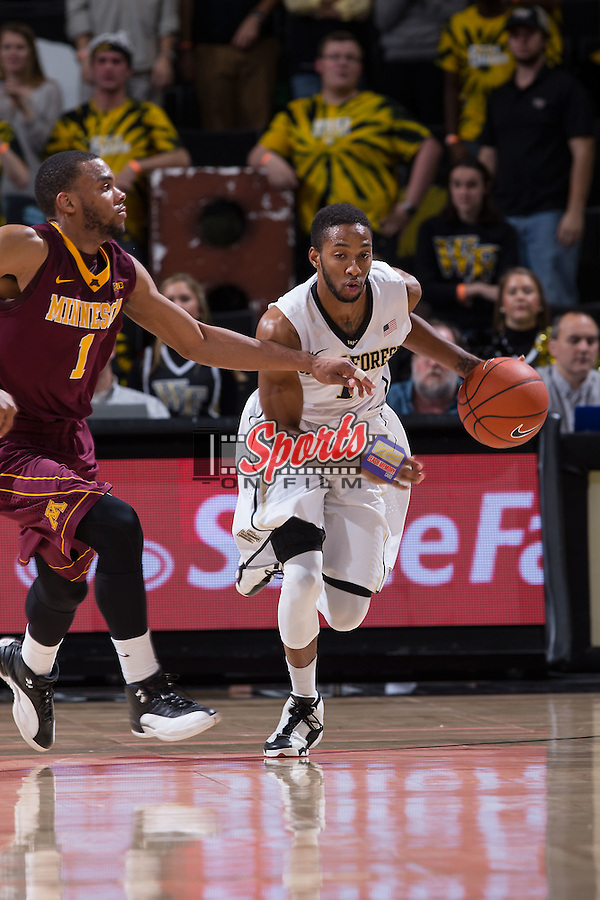 Madison Jones (1) of the Wake Forest Demon Deacons pushes the ball up the court past Andre Hollins (1) of the Minnesota Golden Gophers during first half action at the LJVM Coliseum on December 2, 2014 in Winston-Salem, North Carolina.  The Golden Gophers defeated the Demon Deacons 84-69. (Brian Westerholt/Sports On Film)
