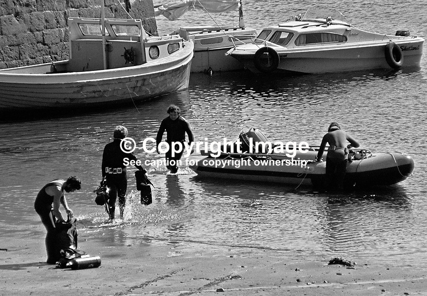 Divers prepare to go out from Mullaghmore, Co Sligo, Rep of Ireland, to search for the wreckage of Shadow V, the boat in which Lord Mountbatten was assasinated by a Provisional IRA bomb. Ref: 197905270094e...Copyright Image from Victor Patterson, 54 Dorchester Park, Belfast, UK, BT9 6RJ..Tel: +44 28 9066 1296.Mob: +44 7802 353836.Voicemail +44 20 8816 7153.Skype: victorpattersonbelfast.Email: victorpatterson@mac.com.Email: victorpatterson@ireland.com (back-up)..IMPORTANT: If you wish to use this image or any other of my images please go to www.victorpatterson.com and click on the Terms & Conditions. Then contact me by email or phone with the reference number(s) of the image(s) concerned.