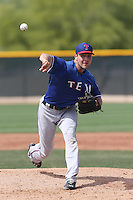 Kyle Lotzkar #37 of the Texas Rangers pitches during a Minor League Spring Training Game against the Kansas City Royals at the Kansas City Royals Spring Training Complex on March 20, 2014 in Surprise, Arizona. (Larry Goren/Four Seam Images)