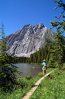 Rocky Mountains, Canadian Rockies, BC, British Columbia, Canada - Hiker hiking on Trail at Mt Elkan and Lower Elk Lake, Elk Lakes Provincial Park near Elkford, Summer (Model Released)
