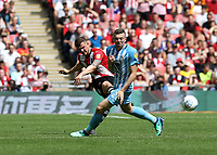 28th May 2018, Wembley Stadium, London, England;  EFL League 2 football, playoff final, Coventry City versus Exeter City; Jake Taylor of Exeter City passes the ball into midfield past Jordan Shipley of Coventry City