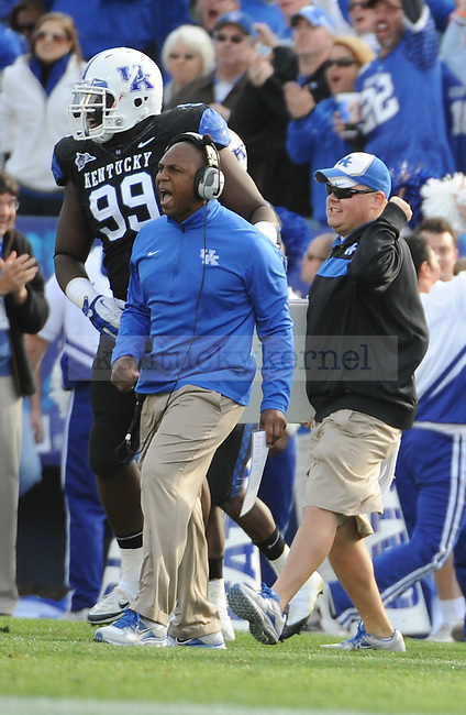 UK Head Coach Joker Phillips celebrates after UK Defensive lineman Collins Ukwu recovers a Tennessee fumble during the third quarter of the University of Kentucky football game against Tennessee at Commonwealth Stadium in Lexington, Ky., on 11/26/11. UK won the game 10-7. Photo by Bob Weaver | Staff