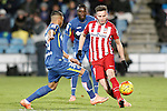 Getafe's Wanderson (l) and Karim Yoda (c) and Atletico de Madrid's Saul Niguez during La Liga match. February 14,2016. (ALTERPHOTOS/Acero)