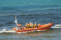 "Aberystwyth Wales UK  Wednesday 31 August 2016<br /> Pictured: The RNLI crew.<br /> Re: Re: A man tried to save his friend who died after falling out of a speedboat, an inquest has been told.<br /> William George Davies, 63, from Borth, died in August after he was thrown overboard during a fishing trip off Aberystwyth.<br /> A second man, Alan Jones, was also thrown overboard but survived.<br /> The inquest at Aberystwyth Justice Centre was told the cause of death was drowning and coroner Peter Brunton recorded a conclusion of misadventure.<br /> Mr Brunton said he had ""concerns"" over the fact the two men were not wearing life jackets, the sea had been ""choppy"" and Mr Jones had taken off the kill cord which would automatically stop the engine if he were thrown overboard.<br /> The inquest heard the men had set out at about 7.30am on 31 August to go fishing, but headed to Aberystwyth harbour a short time later when Mr Davies started to feel unwell - which his friend put down to sea sickness."