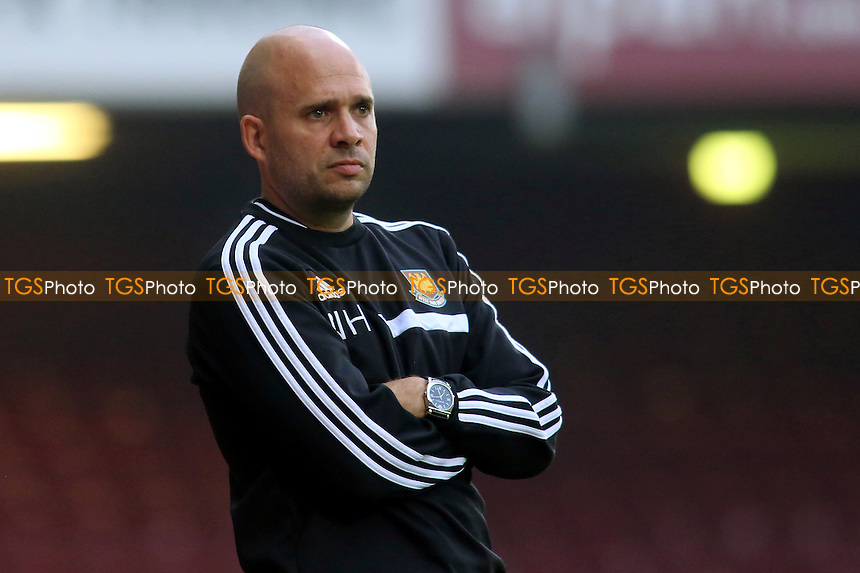 West Ham Under 21 Manager, Nick Haycock, looks dejected as Tottenham win the match after scoring three second half goals - West Ham United Under-21 vs Tottenham Hotspur Under-21 - Barclays Under-21 Premier League Football at The Boleyn Ground, Upton Park, London - 23/08/13 - MANDATORY CREDIT: Paul Dennis/TGSPHOTO - Self billing applies where appropriate - 0845 094 6026 - contact@tgsphoto.co.uk - NO UNPAID USE