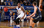 BROOKINGS, SD - NOVEMBER 3:  Chris Howell #3 from South Dakota State controls the ball in front of Jack Fiddler #31 from SD School of Mines in the first half of their exhibition game Thursday evening at Frost Arena in Brookings. (Photo by Dave Eggen/Inertia)