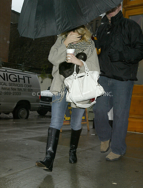 WWW.ACEPIXS.COM ** ** ** ..EXCLUSIVE*** FEE MUST BE NEGOTIATED BEFORE USE!!!....NEW YORK, DECEMBER 7, 2004....On a blustery winter day, Ashley Olsen is seen leaving Pastis with a large white leather bag and an umbrella for protection.....Please byline: Philip Vaughan -- ACE PICTURES... *** ***  ..Ace Pictures, Inc:  ..Alecsey Boldeskul (646) 267-6913 ..Philip Vaughan (646) 769-0430..e-mail: info@acepixs.com..web: http://www.acepixs.com