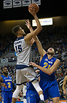 Nevada forward Trey Porter (15) shoots over South Dakota forward Mike Daum (24) State in the first half of an NCAA college basketball game in Reno, Nev., Saturday, Dec. 15, 2018. (AP Photo/Tom R. Smedes)