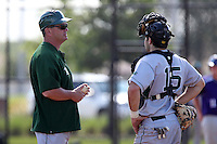 Slippery Rock head coach Jeff Messer #10 makes a pitching change with catcher Matt Accardi #15 during a game against the Winona State Warriors at Lake Myrtle Complex on March 15, 2012 in Auburndale, Florida.  Winona defeated Slippery Rock 10-3.  (Mike Janes/Four Seam Images)