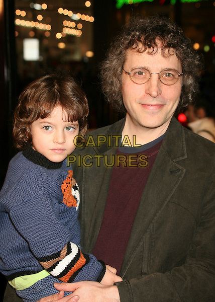 "MARC LAWRENCE & SON.""Music and Lyrics"" Los Angeles Premiere at Grauman's Chinese Theatre, Hollywood, California, USA..February 7th, 2007.half length father family carrying lifting writer director blue top grey gray jacket glasses.CAP/ADM/BP.©Byron Purvis/AdMedia/Capital Pictures"
