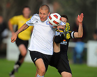 Team Wellington captain Karl Whalen tries to dispossess Mirjan Pavlovic. ASB Challenge Series Football  - Team Wellington v Wellington Phoenix A at David Farrington Park, Wellington on Tuesday, 23 November 2010. Photo: Dave Lintott / lintottphoto.co.nz