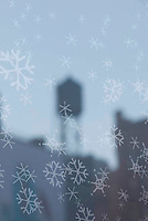 THIS IMAGE IS AVAILABLE EXCLUSIVELY FROM CORBIS.....PLEASE SEARCH FOR IMAGE # 42-20075593 ON WWW.CORBIS.COM.....Reflection in a New York City Store Window at Christmas time , Snowflake Designs on window, reflection of a typical New York City Water Tower, the neighborhood of NoHo, Lower Manhattan, New York City, New York State, USA