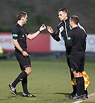 Referee Steven Brown hands over a lighter to the fourth official