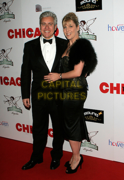 "DAVID IAN & GUEST.The ""Chicago"" 10th anniversary afterparty, Cambridge Theatre, London, England..December 5th, 2007.full length black tuxedo dress.CAP/AH.©Adam Houghton/Capital Pictures"