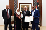 Palestinian President Mahmoud Abbas honors the families of martyrs in the West Bank city of Ramallah, on July 23, 2018. Photo by Thaer Ganaim