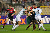 20121020 Copyright onEdition 2012©.Free for editorial use image, please credit: onEdition..Mako Vunipola of Saracens is tackled by Fabrice Estebanez (left) and Juan-Martin Hernandez of Racing Metro 92 during the Heineken Cup Round 2 match between Saracens and Racing Metro 92 at the King Baudouin Stadium, Brussels on Saturday 20th October 2012 (Photo by Rob Munro)..For press contacts contact: Sam Feasey at brandRapport on M: +44 (0)7717 757114 E: SFeasey@brand-rapport.com..If you require a higher resolution image or you have any other onEdition photographic enquiries, please contact onEdition on 0845 900 2 900 or email info@onEdition.com.This image is copyright the onEdition 2012©..This image has been supplied by onEdition and must be credited onEdition. The author is asserting his full Moral rights in relation to the publication of this image. Rights for onward transmission of any image or file is not granted or implied. Changing or deleting Copyright information is illegal as specified in the Copyright, Design and Patents Act 1988. If you are in any way unsure of your right to publish this image please contact onEdition on 0845 900 2 900 or email info@onEdition.com