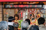 People purchase lottery tickets on the first day of sale for the annual year-end jumbo lottery on November 27, 2017, Tokyo, Japan. From early morning buyers lined up to buy their lottery tickets at the 1st ticket window in Ginza, which is well known for producing big winners. This year's top prize is 1 billion Yen (approx. US$ 8.9 million) and each ticket costs 300 Yen (US$2.69). Ticket sales continue across the country until December 22. (Photo by Rodrigo Reyes Marin/AFLO)