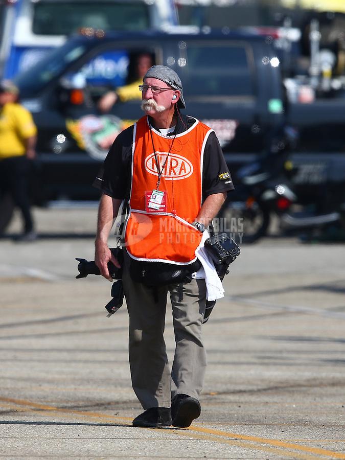 Feb 8, 2014; Pomona, CA, USA; NHRA photographer Roger Richards during qualifying for the Winternationals at Auto Club Raceway at Pomona. Mandatory Credit: Mark J. Rebilas-