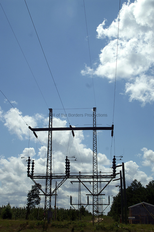 Old fashioned short and broad power line towers can still be seen in rural areas.