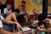 "Monks and pagoda neighbors play ""Co Tuong"" also called ""Chinese Chess"" at the Giac Vien Pagoda in District 11 in Ho Chi Minh City, Vietnam. Photo taken Monday, May 3, 2010...Kevin German / LUCEO"
