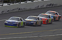 Jimmie Johnson (#48) leads Michael Waltrip (#15), Jeff Gordon (#24) and Robby Gordon (#31) in the closing laps.