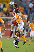 FC Dallas forward Carlos Ruiz and Houston Dynamo midfielder Riuchard Mulrooney go for a header during the second leg of the Western Conference Semifinal Series at Robertson Stadium in Houston, TX on November 2, 2007