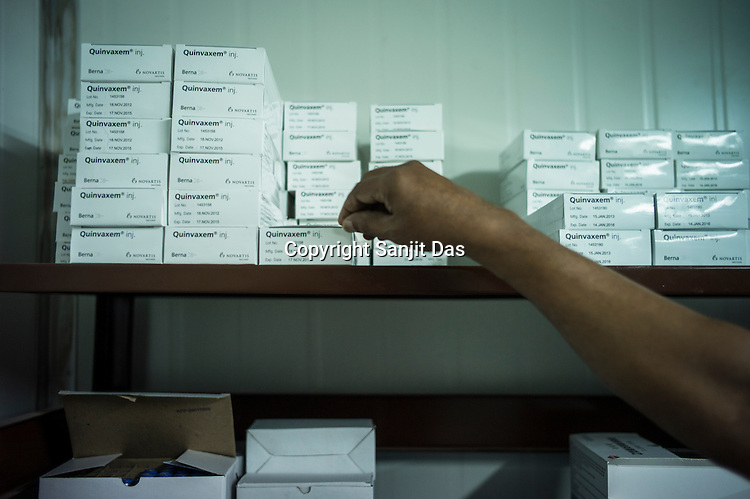 A store assistant pulls out vaccines in the cold storage in Vavuniya, Sri Lanka.  Photo: Sanjit Das/Panos