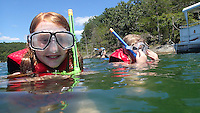 NWA Democrat-Gazette/FLIP PUTTHOFF<br /> A LOOK DOWN UNDER<br /> Kenlee Morris, 10, (left) and Johanna Whisenhunt get ready to explore the underwater world at Beaver Lake on Wednesday August 12 2015 during a snorkeling tour offered by Hobbs State Park-Conservation Area. Snorkelers traveled in the park's pontoon boat to a scenic cove in the Rocky Branch area of Beaver Lake and explored along a rocky shoreline. The park's next snorkeling trip is August 19 from 1 to 4 p.m. The $20 cost includes use of a snorkel, mask and life jacket. Call the Hobbs visitor center, 479-789-5000 to register.