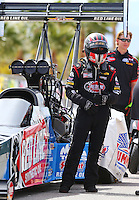 Apr 10, 2015; Las Vegas, NV, USA; Crew members waiting with NHRA top fuel driver J.R. Todd in the staging lanes during qualifying for the Summitracing.com Nationals at The Strip at Las Vegas Motor Speedway. Mandatory Credit: Mark J. Rebilas-