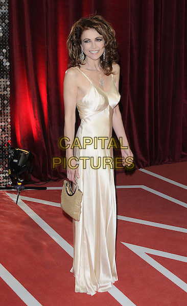 Emma Samms.attended the British Soap Awards 2013, Media City, Salford, Manchester, England, UK, 18th May 2013..arrivals full length gold dress silk satin long maxi bag side .CAP/CAN.©Can Nguyen/Capital Pictures.