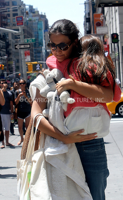 WWW.ACEPIXS.COM . . . . .  ....July 8 2012, New York City....Actress Katie Holmes and her daughter Suri Cruise walk in their Chelsea neighborhood on July 8 2012 in New York City....Please byline: NANCY RIVERA- ACEPIXS.COM.... *** ***..Ace Pictures, Inc:  ..Tel: 646 769 0430..e-mail: info@acepixs.com..web: http://www.acepixs.com