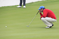 Thomas Aiken (RSA) on the 13th green during Sunday's Final Round of the 2014 BMW Masters held at Lake Malaren, Shanghai, China. 2nd November 2014.<br /> Picture: Eoin Clarke www.golffile.ie
