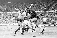 30.07.1966. Wembley Stadium, London England. 1966 World Cup final England versus Germany (4-2) After Extra time.  Bobby Charlton England clattered from the ball by Franz Beckenbauer left and Goalkeeper Hans Tilkowski