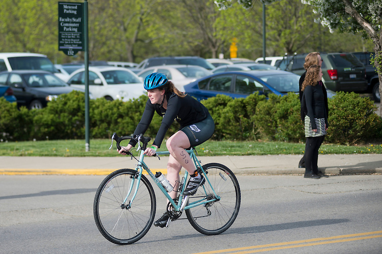 Julie Krause bikes during the O'Bleness Race for a Reason Triathlon Saturday, April 27, 2013. The triathlon included a 500mm Serpentine Swim at the Ohio University Aquatic Center, a 15 mile bike ride to the Plains and back and then a 5k run that finished at Tailgreat Park across from Peden Stadium. . Race for a Reason, Race 4 A Reason, Annual Events, Events, Students, Faculty & Staff