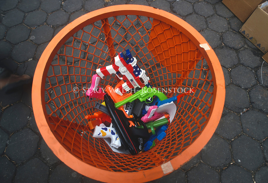 Anti Gun protesters discard toy guns in Prospect Park