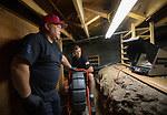 Absolute Drain owner Mickey Castonguay, left, and Mickey II watch a monitor in the basement of a house in Reno, Nevada on Monday, August 14, 2017.