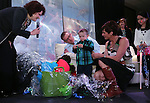 Nevada First Lady Kathleen Sandoval and her daughter Marisa, right, help Kristi and Scott Young and their 3-year-old son Isaac open a gift at the Make-A-Wish Waffles & Wishes event at the Atlantis Casino Resort Spa in Reno, Nev., on Tuesday, March 26, 2013. Isaac, who is fighting liver cancer, received a battery-powered car and his wish of a trip to the San Francisco Bay area through the sponsorship of UnitedHealthcare. .Photo by Cathleen Allison/Nevada Photo Source