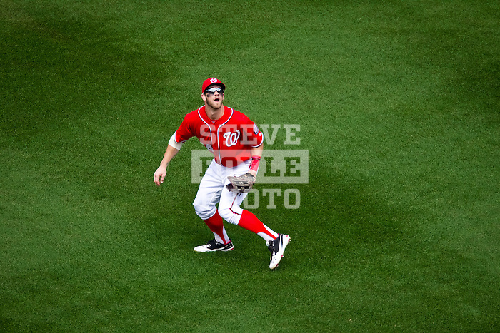 Washington Nationals outfielder Bryce Harper (34) tracks a fly ball during a game against the Miami Marlins at Nationals Park in Washington, DC on September 8, 2012.