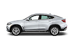 Car Driver side profile view of a 2015 BMW X6 sDrive35i 5 Door SUV Side View