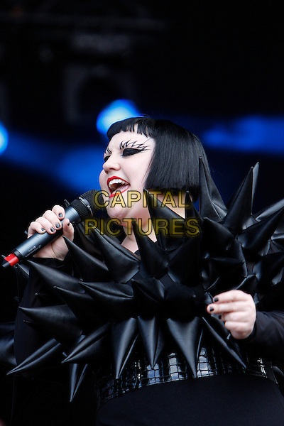 BETH DITTO of GOSSIP .Performing live at Wireless Festival in Hyde Park, London, England, UK, .July 2nd 2010..concert music gig live on stage half length black rubber spiky top spikes make-up eyebrows microphone singing costume outfit top dress eyeliner fringe bob .CAP/MAR.© Martin Harris/Capital Pictures.