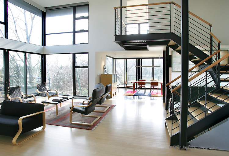 The living room and stairs leading up to the bedroom in the home of John and Trish Morphew-Lewis in Boulder. Like many production houses built in the 1960s and 70s, the South Boulder home had outgrown its original design plan.