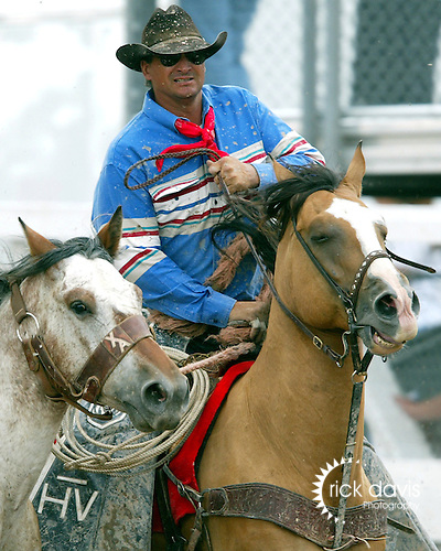A rodeo pickup man working the Cheyenne Frontier Days Rodeo in Cheyenne, Wyoming. Pickup men are responsible for the safety of the stock, as well as offering a safe get-off from broncs for cowboys at the conclusion of an eight second ride.